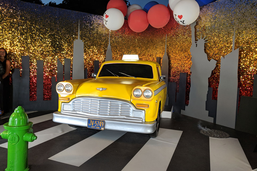 This sparkling sequin wall was produced as a backdrop to the iconic yellow NY taxi and props for the party of 4th July