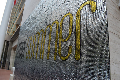 Close up of sequin logo wall for Pop-Up summer Event