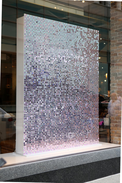 In store sequin wall display for fashion retail merchandising