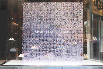 Sequin wall displays hung from store ceiling for maximum impact