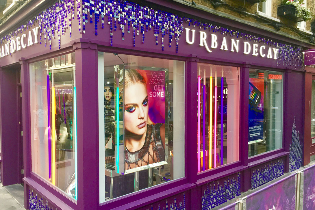 Eye catching store decor with silver and royal purple 30mm sequins in Carnaby Street