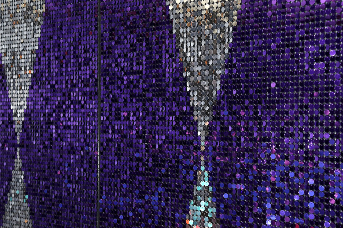 Large decorative sequin wall using purple and silver sequins in 15mm format for corporate VIP area in Germany.