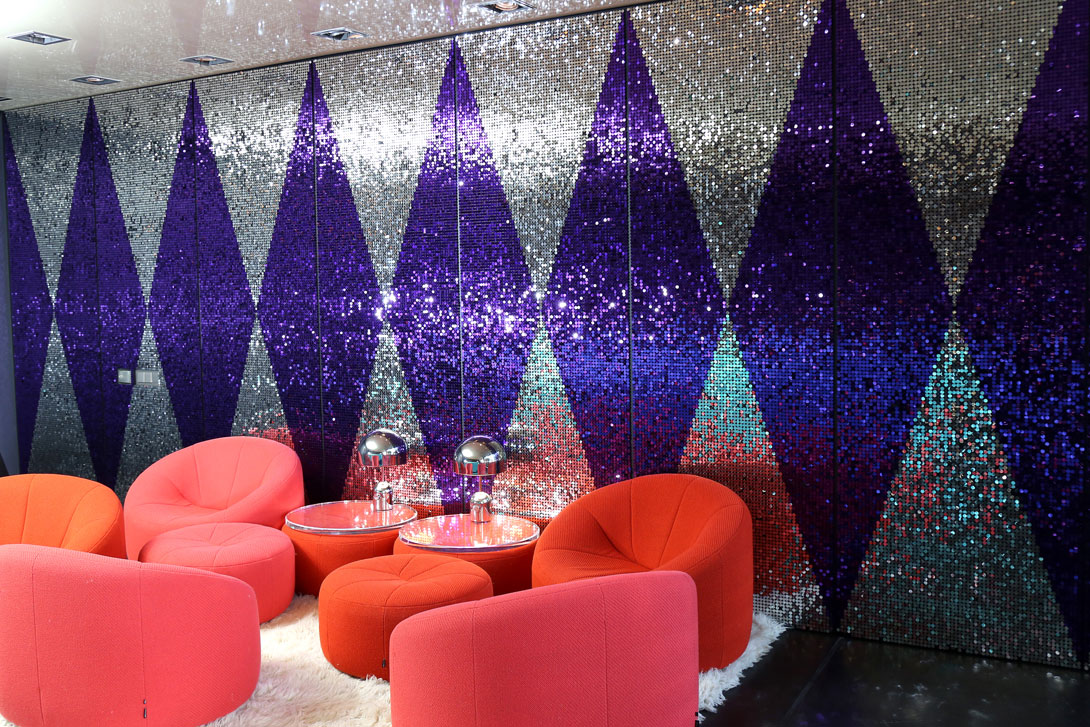 Sequin wall using purple and silver sequins for corporate VIP area in Germany