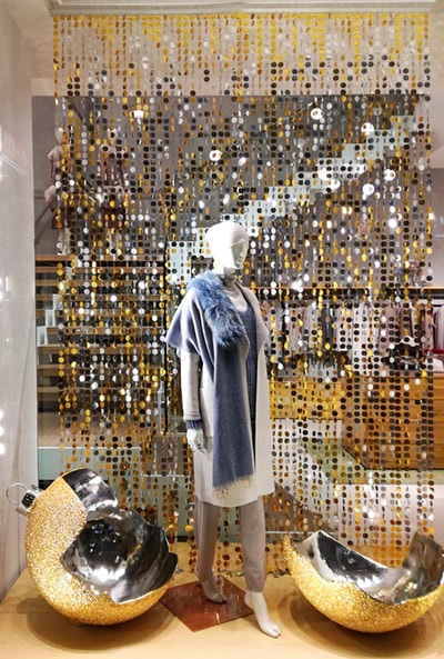 Hanging sequin curtails for store windows- great for Christmas VM
